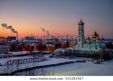 Church at sunset in winter. Perm, Russia. Royalty-Free Stock Photo #555281467