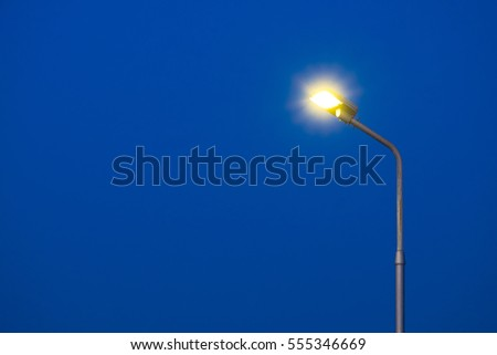 A part of top street light pole with dark blue sky background  in twilight time. #555346669