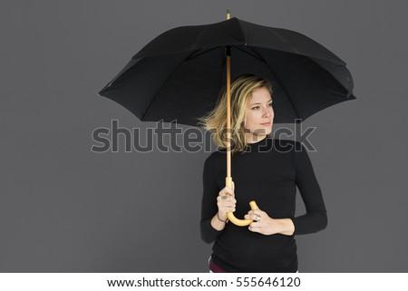 Caucasian Lady Black Umbrella Concept #555646120