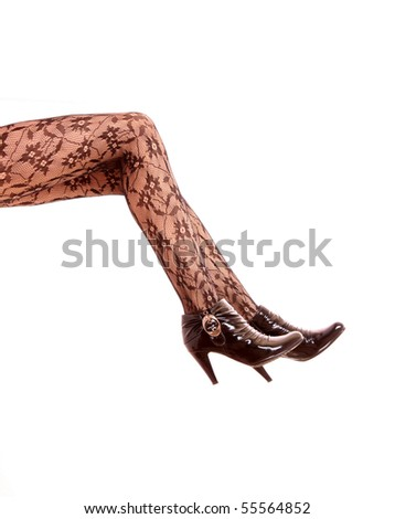 Legs with black high heels isolated against a white background #55564852