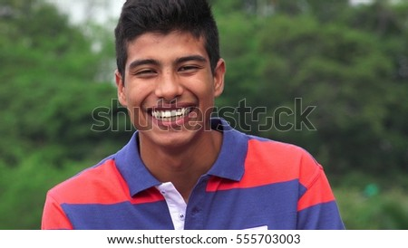 Hispanic Teen Boy Laughing #555703003