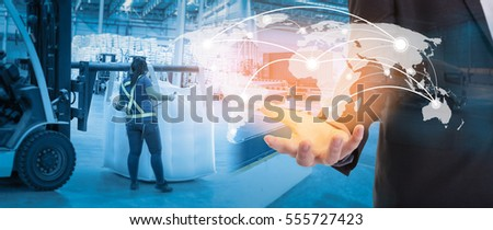 Global network coverage world map on hand of businessman ,Distribution of goods in warehouse process checking for Logistic Import Export background (Elements of this image furnished by NASA) #555727423
