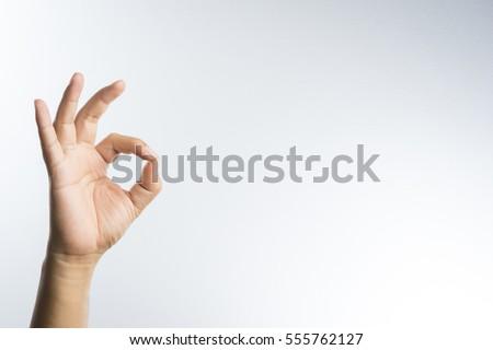 hand ok sign on white background