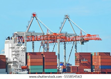 Port cargo crane and container over blue sky background #555854563