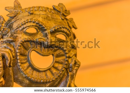 statue of theatrical mask at night #555974566