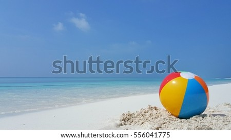 ball on the beach with blue sea and sly background #556041775