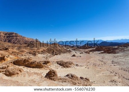 Desert mountains with blue sky in the background  #556076230