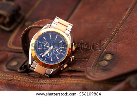 Expensive man wrist watch leather background  Royalty-Free Stock Photo #556109884