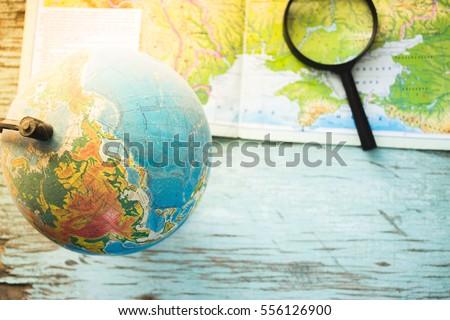 Still globe, magnifier map backround #556126900