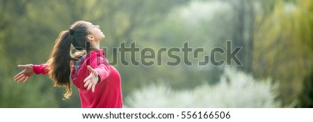 Profile portrait of happy sporty woman relaxing in park. Female model breathing fresh air outdoors. Healthy active concept. Horizontal photo banner for website header design with copy space for text