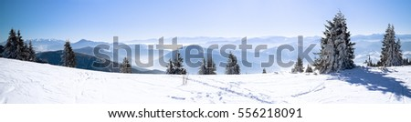 Panoramic view snowcapped mountains, European beautiful winter snowy mountains, High mountain panorama, Winter landscape wallpaper #556218091