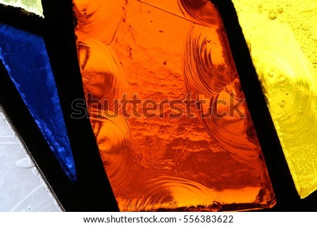 Colorful stained glasses background from a Mexican church #556383622