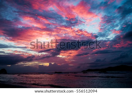 Sunset seascape with dramatic sky and colorful clouds Royalty-Free Stock Photo #556512094