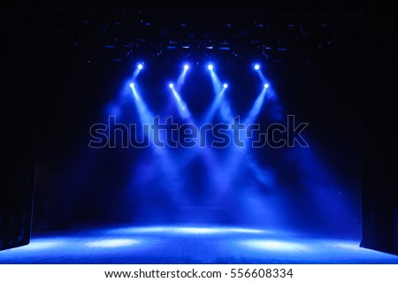 Free stage with lights, lighting devices. Royalty-Free Stock Photo #556608334