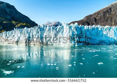 Alaska Glacier Bay landscape view from cruise ship holiday travel. Global warming and climate change concept with melting glacier with Johns Hopkins Glacier and Mount Fairweather Range mountains. Royalty-Free Stock Photo #556661752