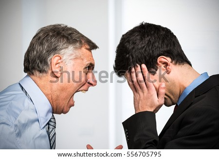 Angry boss shouting to an employee Royalty-Free Stock Photo #556705795