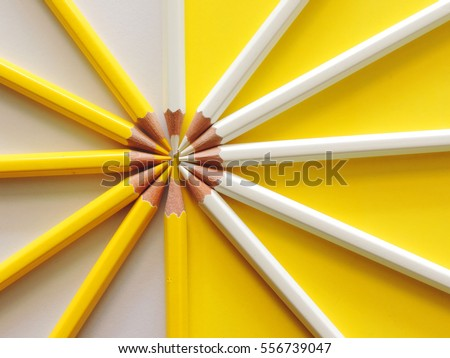 Top view of yellow and white pencil on paper, Competition, teamwork, partnership concept for business.          #556739047