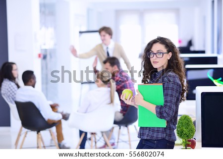 business, startup and people concept - happy creative team with computer and folder in office #556802074