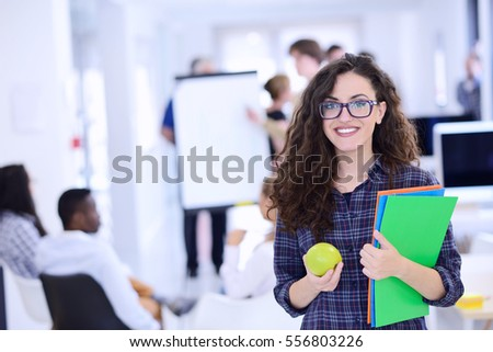 business, startup and people concept - happy creative team with computer and folder in office #556803226
