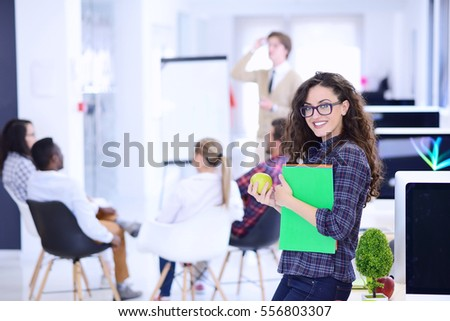 business, startup and people concept - happy creative team with computer and folder in office #556803307