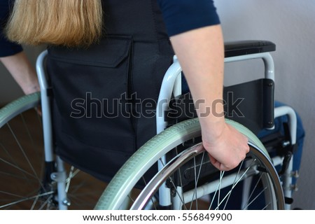 Young woman sitting in a wheelchair #556849900