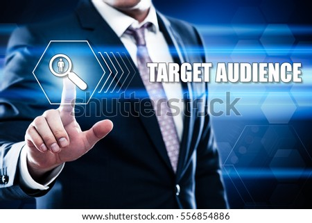 Business, technology, internet concept on hexagons and transparent honeycomb background. Businessman  pressing button on touch screen interface and select  target audience #556854886