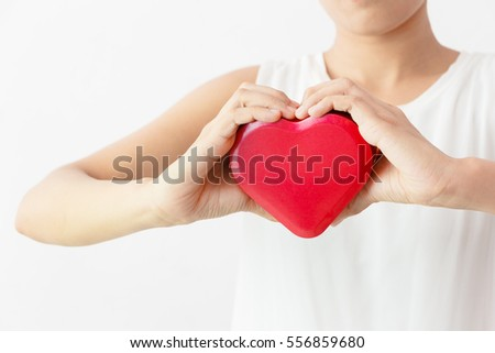Hands holding red heart #556859680