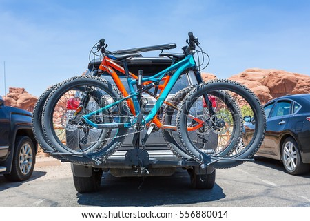 Bikes loaded on the back of a car. Royalty-Free Stock Photo #556880014