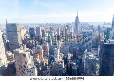 Manhattan with Empire State Building panorama #556884994