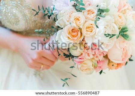 Wedding bouquet of the bride, the wedding bouquet, wedding floristry #556890487