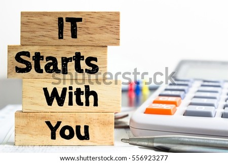 Text message It starts with you on wooden with office table. Business concept #556923277