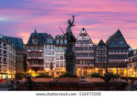 Frankfurt Old town square romerberg with Justitia statue in Frankfurt Germany. Royalty-Free Stock Photo #556973500