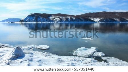 Borders of Lake Baikal and Angara River,winter landscape,Siberia #557051440