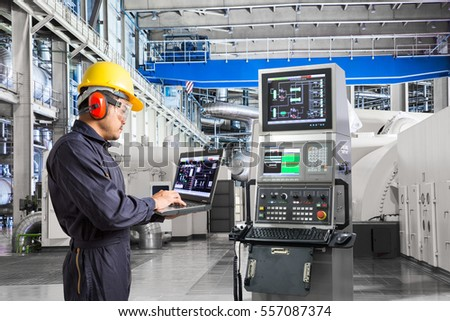 Engineer using laptop computer for maintenance equipment in thermal power plant factory #557087374