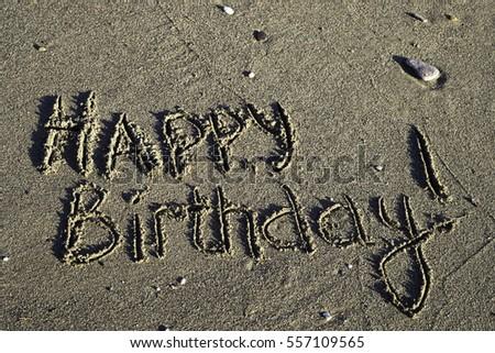 Words on the sand. Happy birthday!