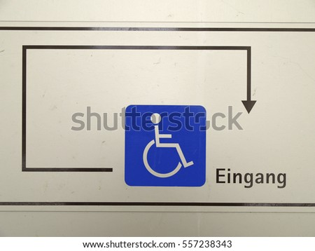 Direction sign to the entrance for disabled people #557238343