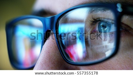 macro eyes web surfer and the office worker, insurance broker, workaholic, while working in the office evenings, control and security in the accesses, security, concept of internet web application. Royalty-Free Stock Photo #557355178