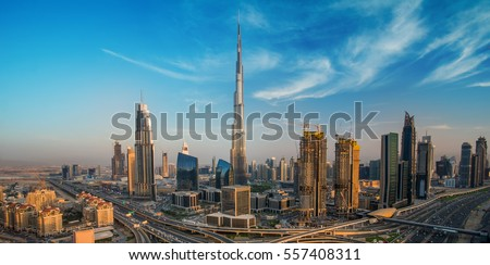 Dubai skyline with beautiful city close to it's busiest highway on traffic Royalty-Free Stock Photo #557408311