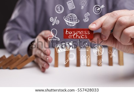 Business, Technology, Internet and network concept. Young businessman shows the word: business ethics 