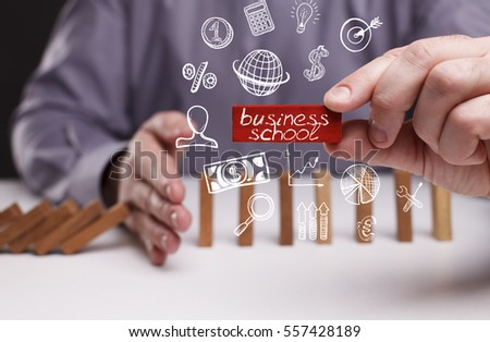 Business, Technology, Internet and network concept. Young businessman shows the word: business school 