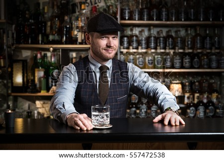 Bartender bartender is pouring a drink #557472538