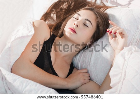 Deeply sleeping woman in morning portrait. Tired woman have rest after hard work day or crazy party. Drunk dream, sleeping pill, exhaustion, tiredness concept #557486401