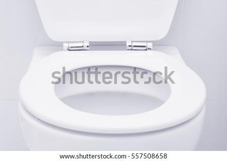 White toilet in the bathroom #557508658