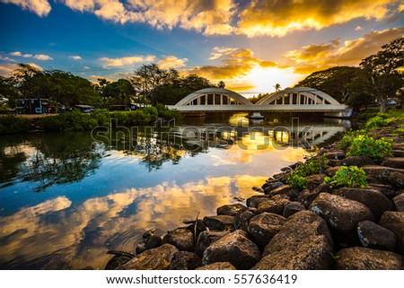 Sunrise over the Anahulu Stream Bridge in Haleiwa, Oahu, Hawaii Royalty-Free Stock Photo #557636419