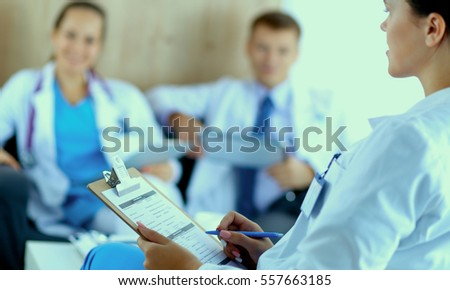 Happy medical team discussing and working together #557663185