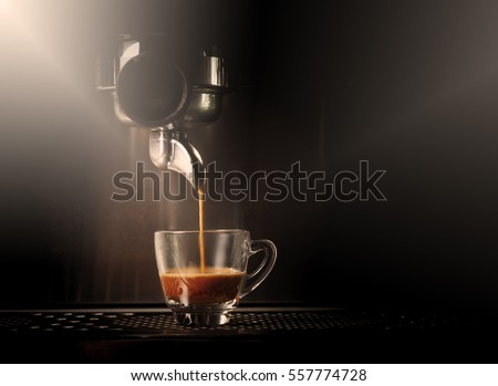 Hot coffee flow to a cup on espresso machine #557774728