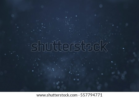 abstract gradient blue background with bokeh and particles flowing, events festive holiday overlay ready concept Royalty-Free Stock Photo #557794771