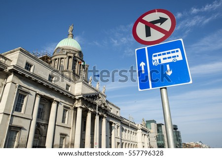 A bus lane sign outisde the Custom House at the city of Dublin in Ireland.