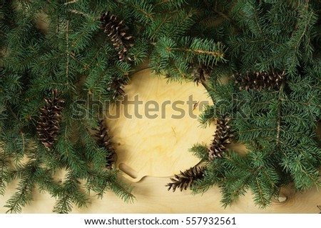 Wooden background with branches of Christmas tree label #557932561