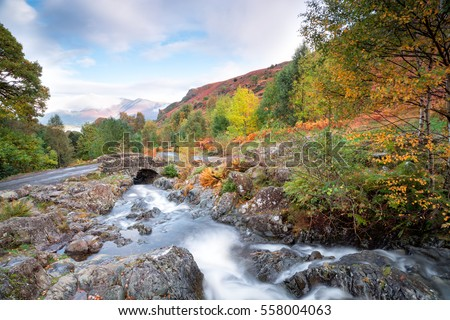 Water flowing under Ashness Bridge near Keswick in the Lake District #558004063